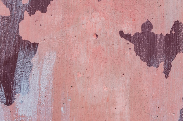 O rosa abstrato do grunge pintou a textura concreta do fundo. parede vintage de estilo antigo