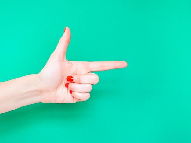 O sinal de mão de arma de dedo