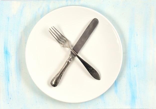 O sinal dos talheres na mesa