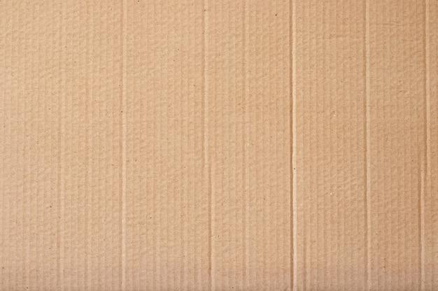 O sumário marrom da folha do cartão, textura de recicla a caixa de papel no teste padrão velho do vintage para o trabalho de arte do projeto.