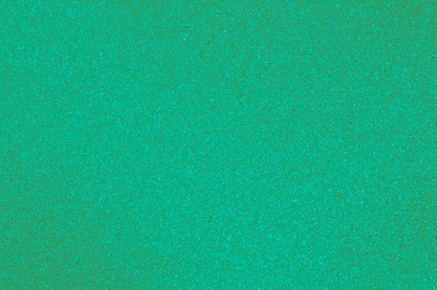 O uso da luz lustrada da textura do granito - cor verde para o fundo.