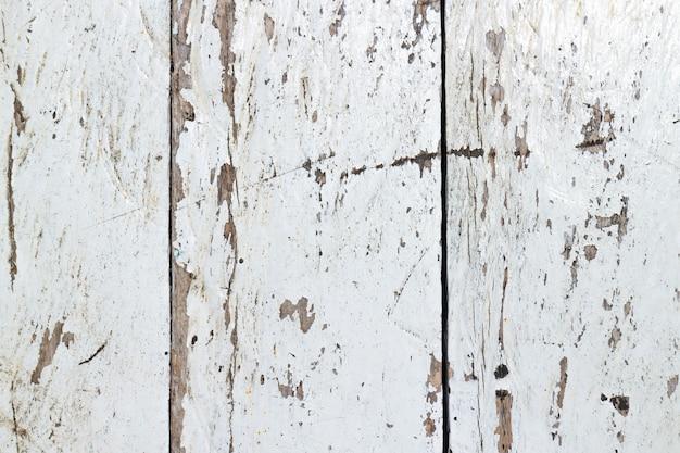 O vapor do mar riscou a textura de madeira pintada branca, velha e vintage. perfeito para o fundo.