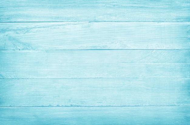 O vintage pintou a parede de madeira, textura da cor pastel azul com testes padrões naturais para o trabalho de arte do projeto.