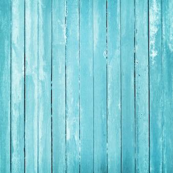 O vintage pintou o fundo de madeira da parede, textura da cor pastel azul com superfícies naturais para o trabalho de arte do projeto.