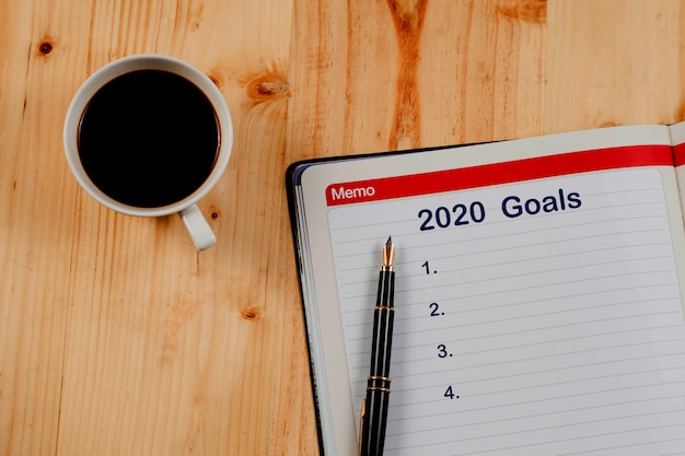 Objetivos de 2020 planejam a lista na nota de livro, plano de negócios.