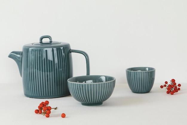 Objetos de cozinha mínimos abstratos, xícaras e bule