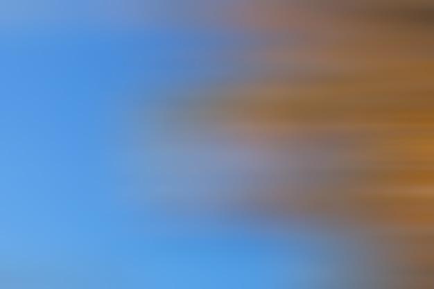 Objetos de linhas borradas de fundo abstrato laranja e amarelo