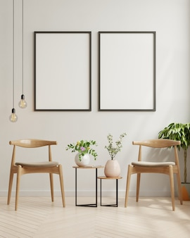 Obras de arte emolduradas em branco no design de interiores de uma sala de estar moderna com uma parede branca vazia.