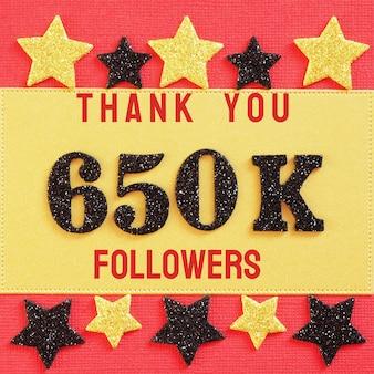 Obrigado 650k, 650000 seguidores. mensagem com números brilhantes pretos em vermelho e dourado