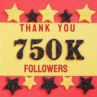 Obrigado 750000, 750 mil seguidores. mensagem com números brilhantes pretos em vermelho e dourado