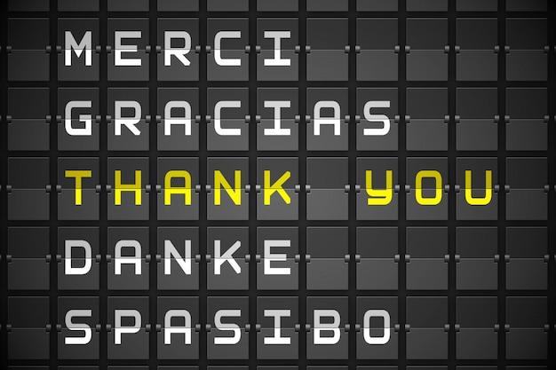 Obrigado em idiomas na placa mecânica preta