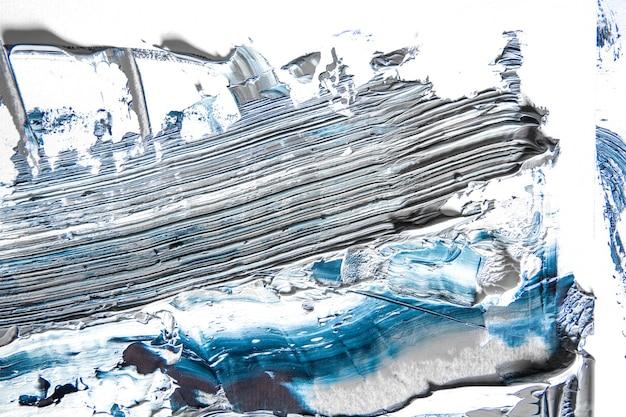 Oceano. creme pintura texturizada em fundo transparente, arte abstrata. papel de parede para dispositivo, copyspace para publicidade. o produto artístico do artista, bicolor. inspiração, ocupação criativa.
