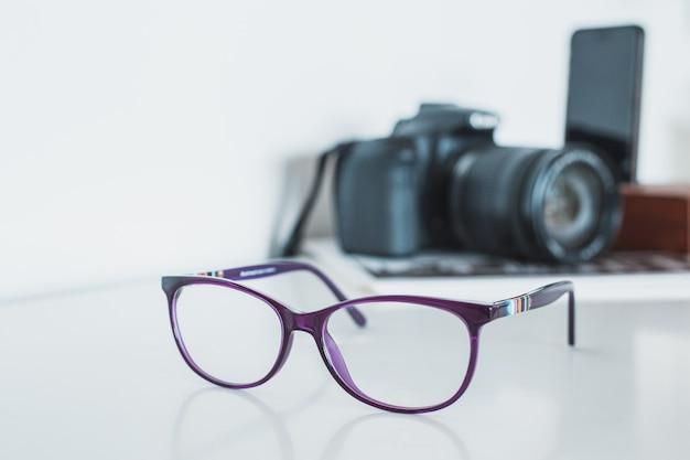 Óculos com câmera e telefone