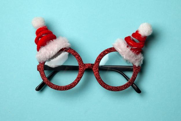 Óculos de papai noel elegantes de ano novo em azul
