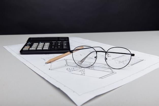 Óculos de planta arquitetônica e custo de construção de calculadora