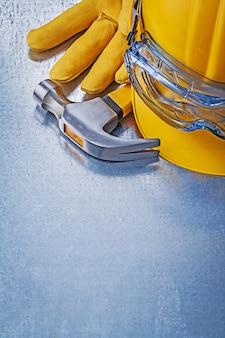 Óculos de proteção, construção de luvas de couro capacete martelo, conceito de construção