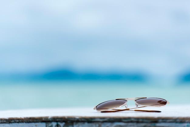 Óculos de sol acessórios de verão oceano areia relaxamento