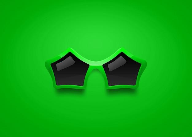 Óculos de sol da forma com forma da estrela no fundo verde.