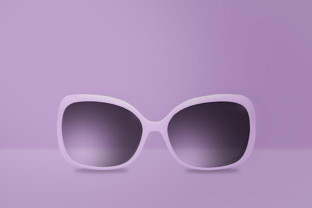 Óculos roxos em um fundo roxo. imagem mínima.