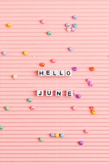 Olá june miçangas palavra tipografia rosa