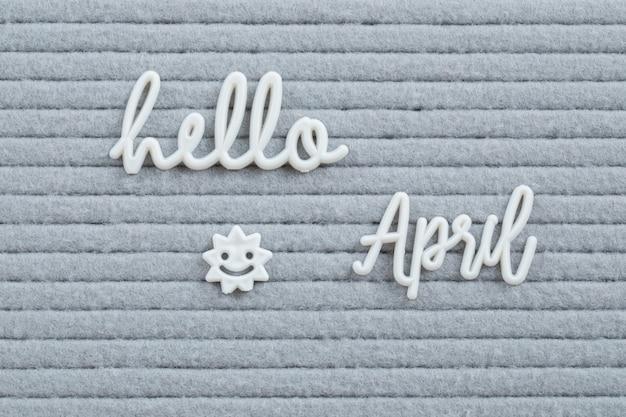 Olá, nomes de meses embutidos na superfície cinza