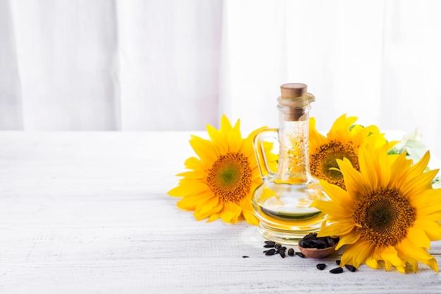 Óleo de girassol, sementes e flores