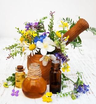 Óleo natural com flores silvestres