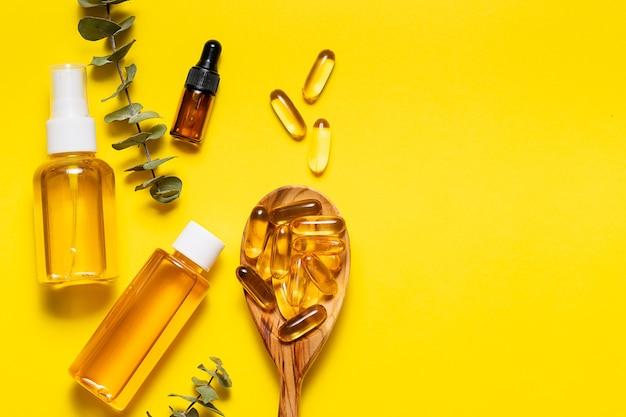 Óleos essenciais, soro natural e cápsulas de óleo de fígado de bacalhau ômega 3