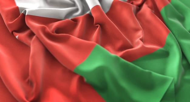 Oman flag ruffled beautifully waving macro close-up shot