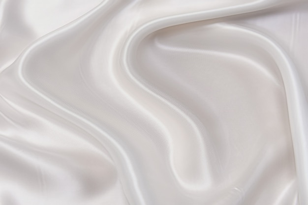 Onda de foco abstrato e suave de fundo de tecido branco ou marfim, textura branca e detalhes