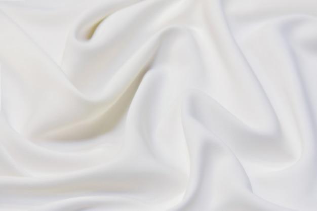 Onda de foco abstrato e suave de fundo de tecido branco, textura branca e detalhes