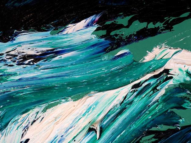 Ondas de oceano. movimento que pinta a textura colorida. as cores brilhantes abstratas do fundo artísticas espirram.