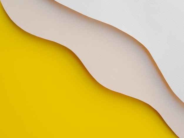 Ondas de papel abstrato amarelo e branco