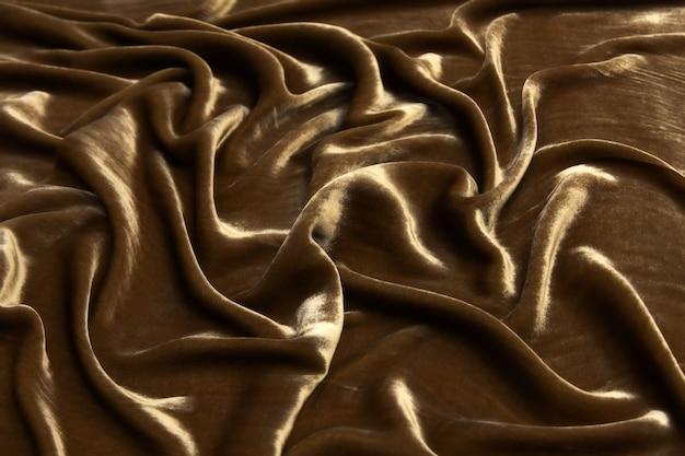 Ondas luxuosas de fundo de tecido de veludo marrom escuro.
