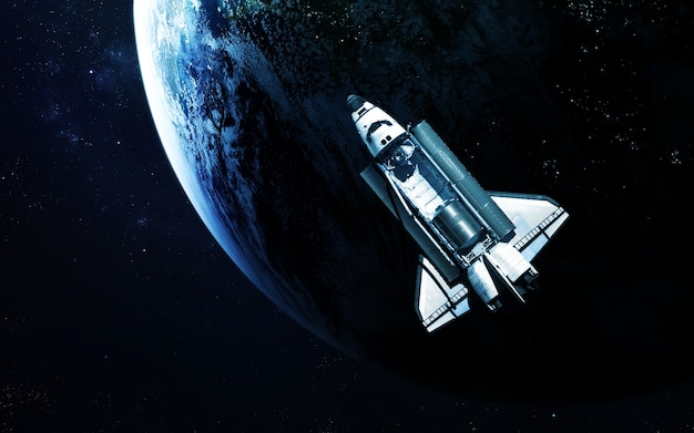 Ônibus espacial orbitando o planeta terra