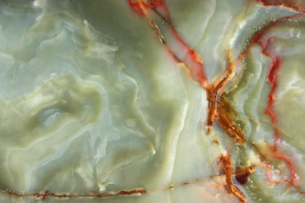 Ônix verde com veios vermelhos, a superfície da pedra natural.