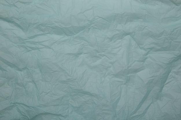 Opinião do close up do fundo do papel azul.