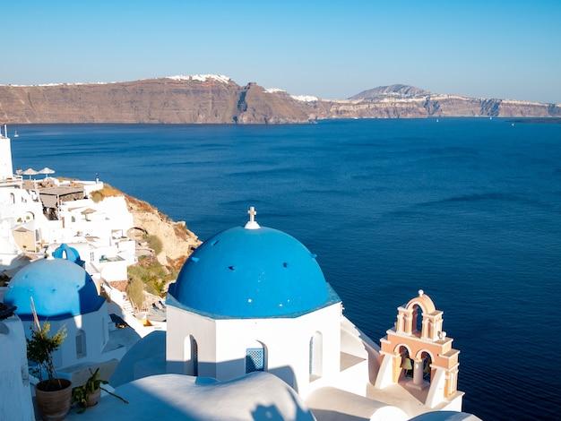Opinião do por do sol de oia, ilha de santorini, grécia.