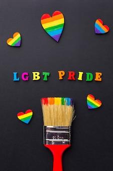 Orgulho lgbt com pincel e corações
