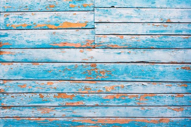 Origens da textura de madeira velha azul, laranja. listras horizontais, placas. rugosidade e fissuras.
