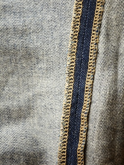 Os detalhes de tecido jeans azul