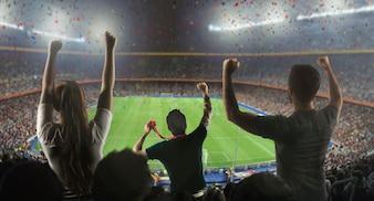 Os fãs de futebol no estádio por trás
