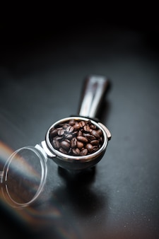Os grãos de café para o compactador de café
