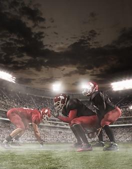 Os jogadores de futebol americano em ação no estádio