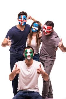 Os rostos dos fãs de futebol pintados apoiam as seleções da croácia, nigéria, argentina, islândia