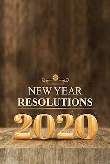 Ouro brilhante 2020 resoluções de ano novo (renderização em 3d) na mesa de madeira do bloco e borrão na parede de madeira