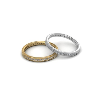 Ouro e prata com anéis de casamento de diamante isolado fundo branco