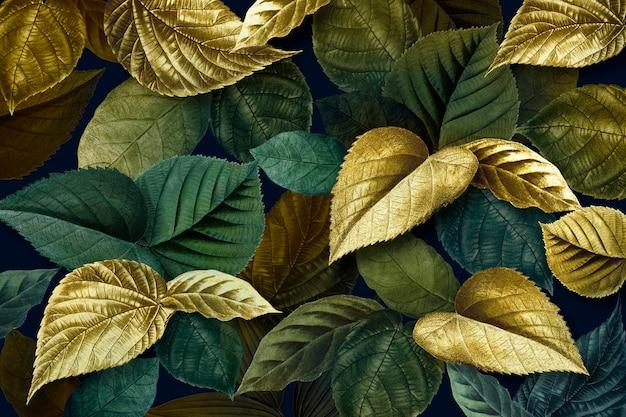 Ouro metálico e folhas verdes com fundo texturizado