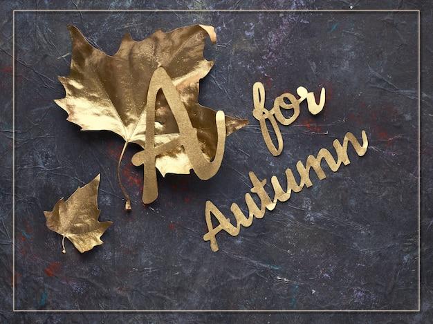 Outono plano leigos com folhas douradas pintadas e o texto