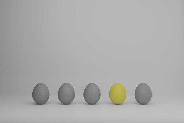 Ovos amarelos e cinzentos em uma fileira